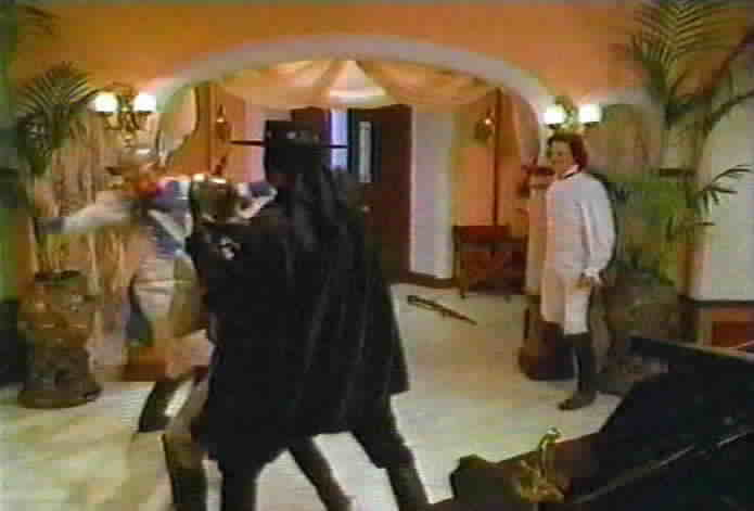 Resendo and Zorro fight each other inside the de la Vega hacienda.