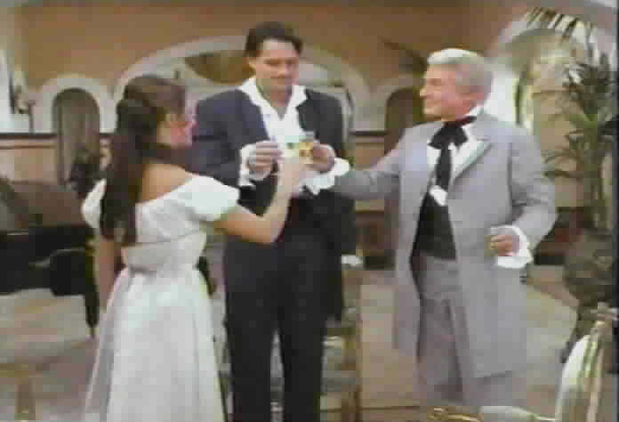 Se�ora de la Pena, Diego, and Don Alejandro make a toast.