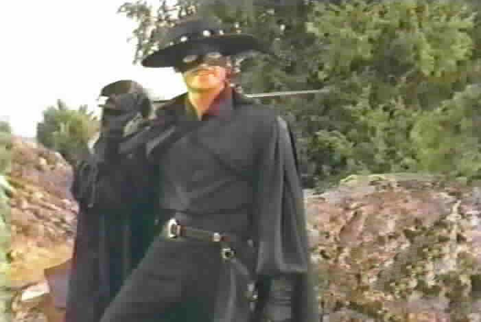 Zorro confronts the bandits responsibile for shooting his father.