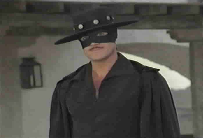 Zorro prepares to fight the alcalde in the plaza.