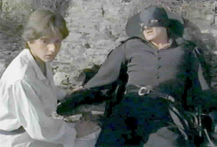 Zorro urges Felipe to leave him before the soldiers arrive.