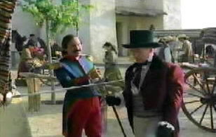 Sir Edmund arrives in the pueblo and refuses to pay the traveler's tax.