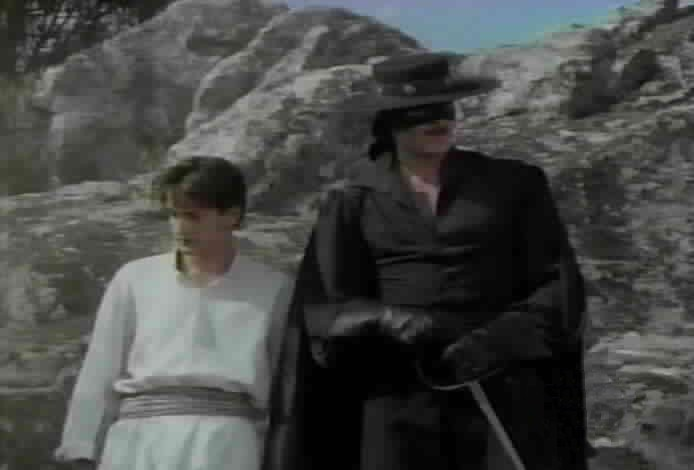 Zorro saves Felipe from the bandits.