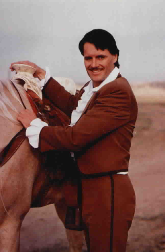 Don Diego standing next to his horse